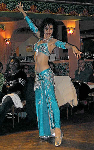 Photo of Bonita dancing in blue costume.